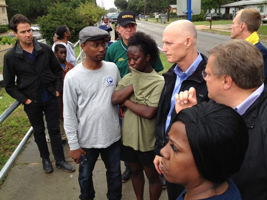 Florida Gov. Rick Scott visits with residents at Forest Creek Apartments. The apartments were heavily flooded during the past two days of severe weather.
