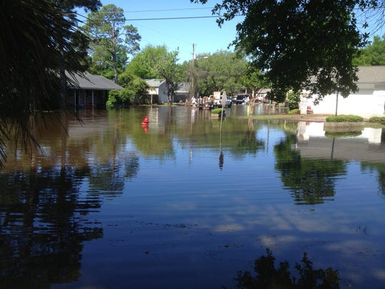 A flooded neighborhood at the intersection of South Sunset Drive and Poiciana Drive in Gulf Breeze.