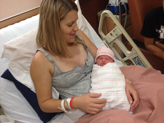 A 25-year-old woman gave birth to her baby girl in a Mesa parking lot on Wednesday, July 30.