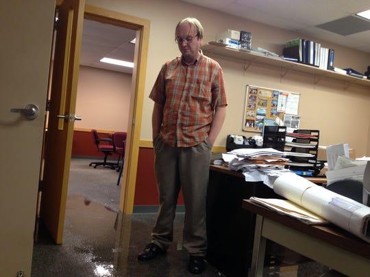 Baileys Harbor Clerk-Administrator Doug Smith  surveys the water damage in his office.
