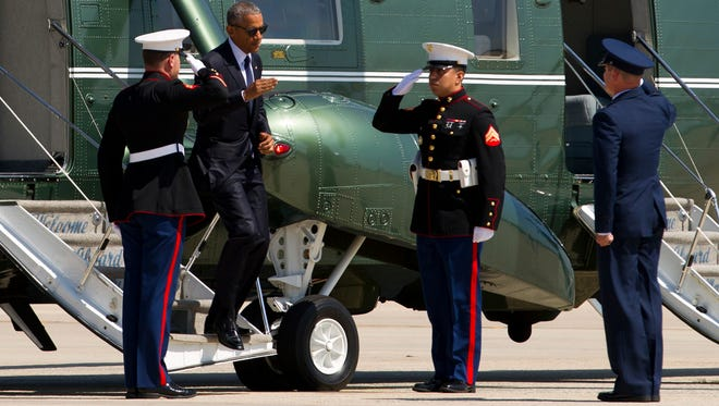Marine Cpl. Santos Reyes salutes President Barack Obama on Tuesday at Andrews Air Force Base in Maryland. Reyes graduated from Channel Islands High School in 2007 and from Oxnard College in 2010. He has been in the Marine Corps for three years.