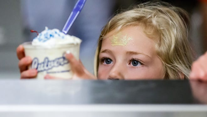 A child takes a Culver's sundae during a summer reading program event on Monday, June 11, 2018 in Hales Corners, Wisconsin.