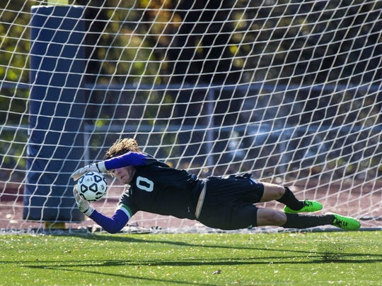 Rice Memorial's Leland Gazo makes a save against CVU the Division I high school boys soccer championship on Oct. 31.