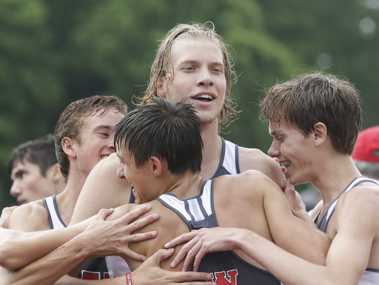 Cooper Williams (center) celebrates with West Lafayette teammates after a relay win at Saturday's state finals. The IU recruit was named the meet's Mental Attitude Award winner for West Lafayette, which finished in fifth place.