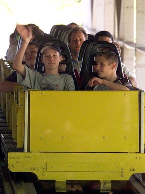 1999: Toms River East American Little Leaguer Steve Bernath (left) waves after he and teammate Eric Campesi finished a run on Rolling Thunder at Six Flags Great Adventure. The team was treated to a day at the park.