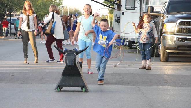 Six-year-old Hi Chadwick tries to rope a plastic bull at the first Hertiage Fest Wednesday, Oct. 18, 2017. The event was hosted by Carlsbad MainStreet in a partnership with Carlsbad Municipal Schools.