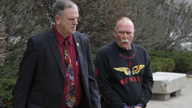 Robert Moran, member of the Hells Angels, right, is escorted from federal court in Rochester in April  2011.