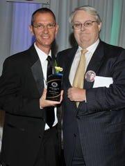 Kevin Meath, right, presents the Eddie Meath Volunteer