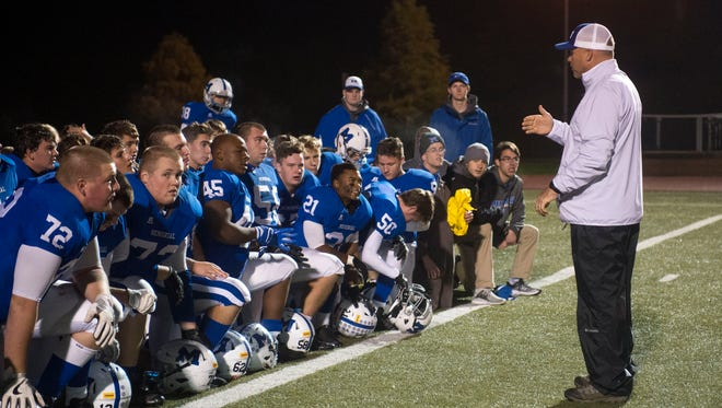 Memorial coach John Hurley speaks to the team after the Tigers' 49-15 Class 3A Sectional 32 win over Washington Friday at Romain Stadium.