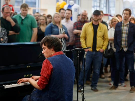 A crowd gathers as Des Moines singer-songwriter Max