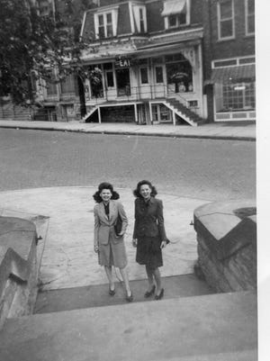 Judy Michaels, left, and her friend Janet Cloud approach the steps of Birchard Library, 1948.