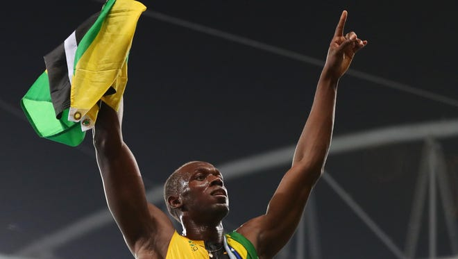 Aug 19, 2016: Usain Bolt (JAM) celebrates after winning the men's 4x100m relay final in the Rio 2016 Summer Olympic Games at Estadio Olimpico Joao Havelange.