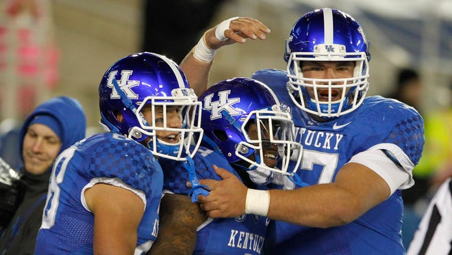 Nov 21, 2015; Lexington, KY, USA; Kentucky Wildcats running back Jojo Kemp (3) celebrates with offensive guard Jarrett LaRubbio (67) in the second half against the Charlotte 49ers at Commonwealth Stadium.