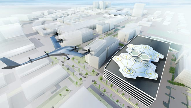 In this conceptual sketch, a vertical take off and landing craft hovers above the skyline of Dallas, one of Uber's new partners aiming to develop a flying car network by 2020.