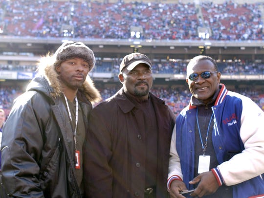 Former New York Giants L-R: Carl Banks, Lawrence Taylor and Harry Carson on the sidelines before an NFC wildcard game January 8, 2006 at the Meadowlands. The Carolina Panthers defeated the Giants 23-0.