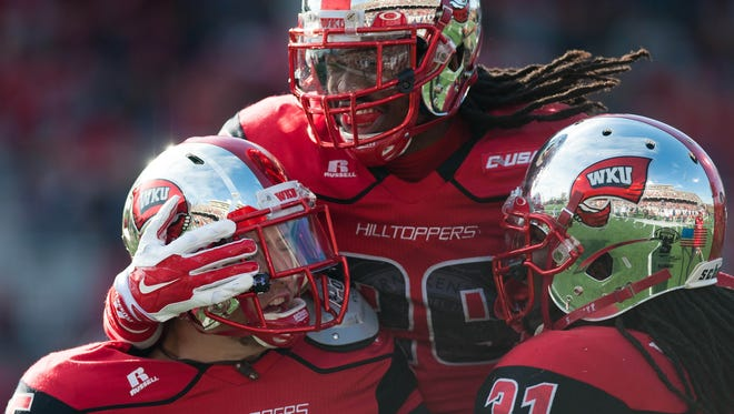 Nov 22, 2014; Bowling Green, KY, USA; Western Kentucky Hilltoppers linebacker Branden Leston (45) celebrates with defensive back Leverick Johnson (29) and linebacker Terran Williams (31) after scoring a touchdown against UTSA Roadrunners during the second half at Houchens Industries-L.T. Smith Stadium. Mandatory Credit: Joshua Lindsey-USA TODAY Sports