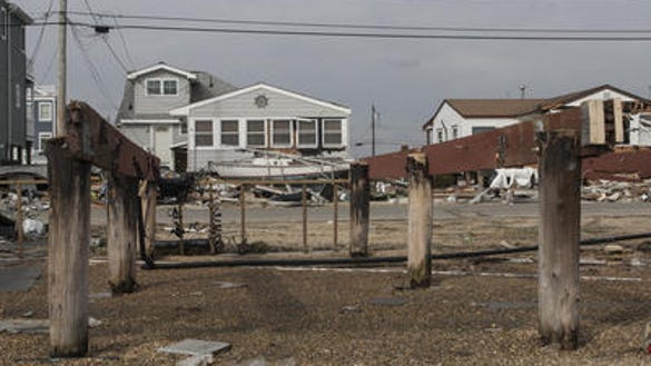 File photo of pilings and homes in Tuckerton (Credit: Peter Ackerman/Staff Photographer)