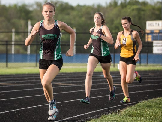 Yorktown's Madeline Aul runs in the 1,600 during the