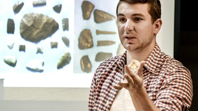 Chad Myers, Kalvesta, talks about quartz crystals he has found in southwest Kansas while giving a presentation on the Finney County Historical Museum's arrowhead collection during a past session of the Evening at the Museum series. The monthly series, as well as a noon version, will be starting back up next week.