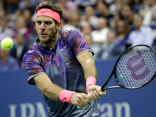 Juan Martin del Potro, of Argentina, hits a backhand to Roger Federer, of Switzerland, during the quarterfinals of the U.S. Open tennis tournament, Wednesday, Sept. 6, 2017, in New York. (AP Photo/Julio Cortez)