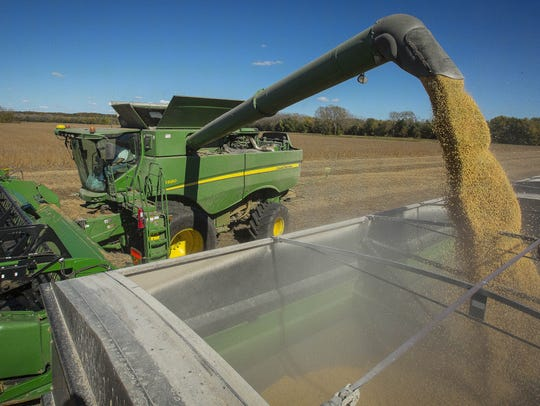 Howard Goodhue combines soybeans near Carlisle, Iowa,