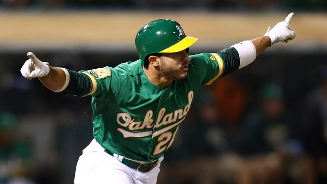 Oakland Athletics' Ramón Laureano celebrates after making the game winning hit against the Detroit Tigers in the 13th inning of a baseball game Friday, Aug. 3, 2018, in Oakland, Calif. (AP Photo/Ben Margot)