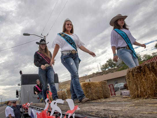 San Juan County Fair Queen Kaylee Madewell, center,