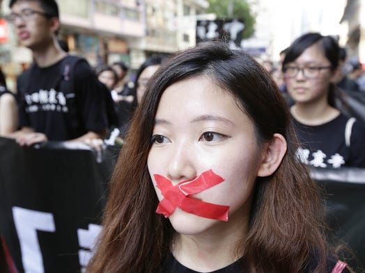 In Hong Kong, pro-democracy activists march to the Government Offices in Admiralty on June 1 to mark the 25th anniversary of  the Tiananmen Square massacre.