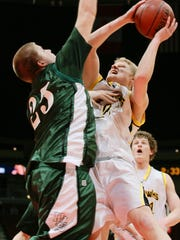 Pella's Kirk Korver tries to block the shot of Waverly-Shell Rock's Phillip Broome during the first half of their game at the Iowa State Basketball Tournament at Wells Fargo Arena on May 14, 2007.