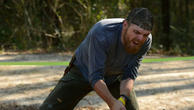 Nathan Molers competes in the standing chop during the 28th annual Forestry Conclave and Lumberjack Festival at Pensacola State College's Milton Campus. The event returns Saturday.