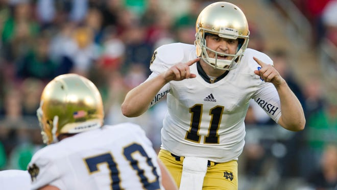Notre Dame Fighting Irish quarterback Tommy Rees (11) yells to his teammates in the first quarter against the Stanford Cardinal at Stanford Stadium.
