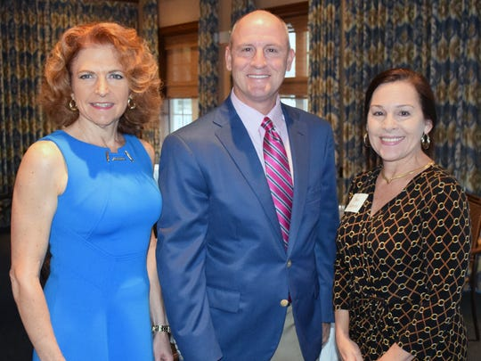 Kerry Bartlett, Bryan Clontz and Dee Giannotti at the Planned Giving Committee Breakfast at the Quail Valley River Club.