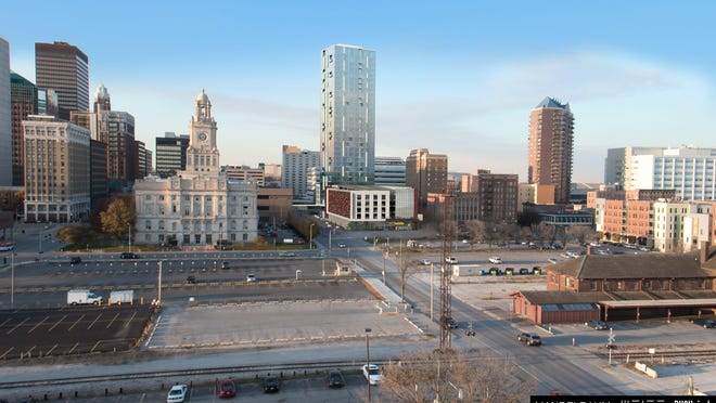 A local developer wants to build an $85 million mixed-use development at Fifth and Court avenues anchored by a 32-story apartment tower. In this rendering, the proposed tower is shown at center in the Des Moines skyline.