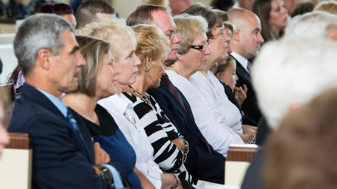 The audience mourns the death of Judge James Kingsley at the Goodrich Chapel in Albion Saturday afternoon.