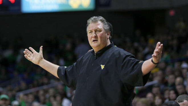 West Virginia coach Bob Huggins gestures to his team during the first half of an NCAA college basketball game against Marshall in Charleston, W.Va., on Thursday, Dec. 17, 2015. (AP Photo/Tyler Evert)