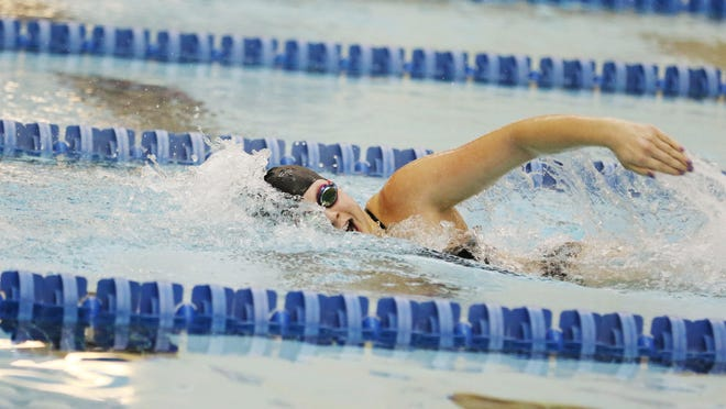 McNary's Marissa Kuch competes in the 200-yard freestyle during a Greater Valley Conference dual meet on Thursday, Jan. 14, 2016, at the Kroc Center.