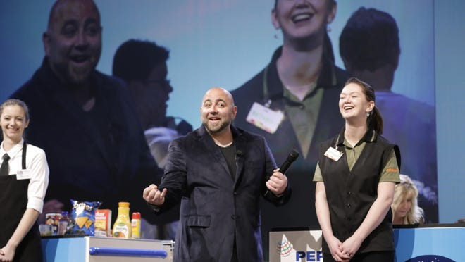 Bethany Berger from Shaw's Supermarket in Colchester is interviewed by Food Network star Duff Goldman during the National Best Bagger Competition in Las Vegas. The Vermont state champ finished second in the nation.