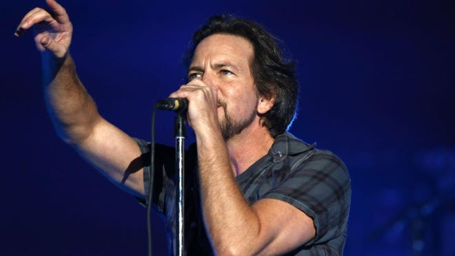 Eddie Vedder, of Pearl Jam, performs at the Global Citizen Festival in Central Park in New York. Rock bands Pearl Jam and Boston are canceling shows in North Carolina over the state's new law on LGBT rights.