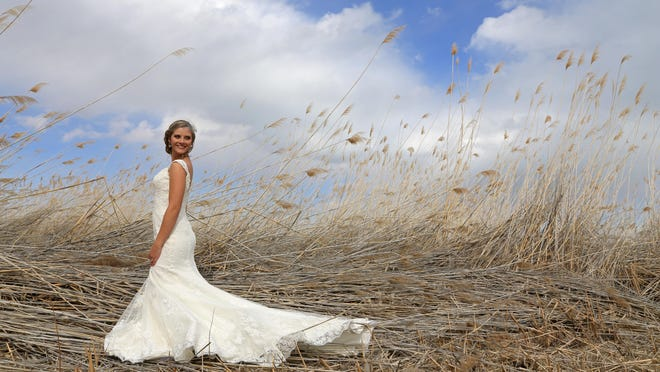 Katie Michaelson Hanks, of Cedar City, poses for a photo on the shores of Bear Lake on her wedding day.