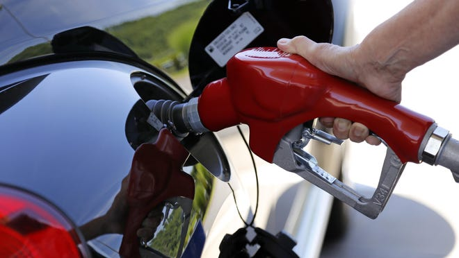 The U.S. government says the fuel economy of the nation's fleet of cars and trucks might not meet its targets in 2025 because low gas prices have changed the types of vehicles people are buying.