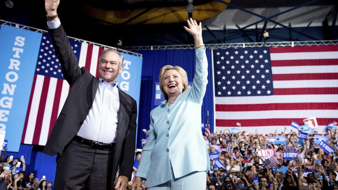Democratic presidential candidate Hillary Clinton and Sen. Tim Kaine, D-Va., arrive at a rally at Florida International University Panther Arena in Miami, Saturday.