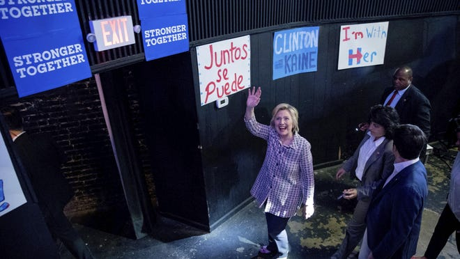 Democratic presidential candidate Hillary Clinton waves to supporters as she departs after speaking to volunteers at a Democratic party organizing event at the Neighborhood Theatre in Charlotte, N.C., Monday, July 25, 2016. (AP Photo/Andrew Harnik)