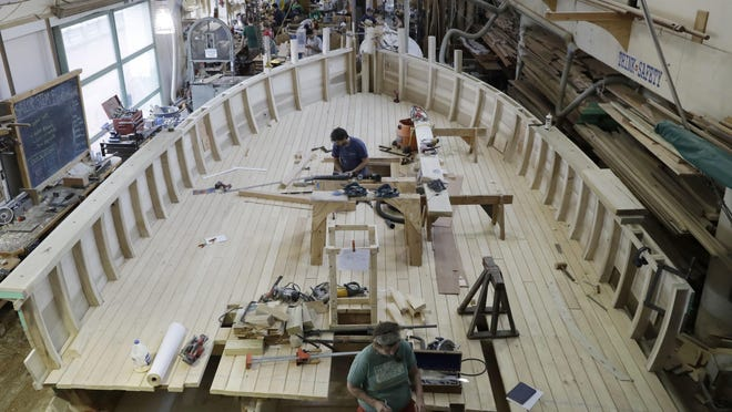 Builders work on a replica of a privateer ship for the Museum of the American Revolution at the Independence Seaport Museum in Philadelphia on July 13.