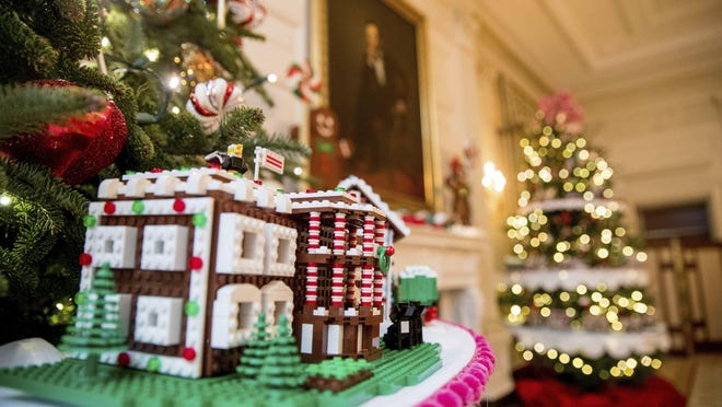 The White House, is one of the fifty-six LEGO gingerbread houses, one for each state and territory, displayed in the trees in the State Dinning Room at the White House during a preview of the 2016 holiday decor, Tuesday, Nov. 29, 2016, in Washington.