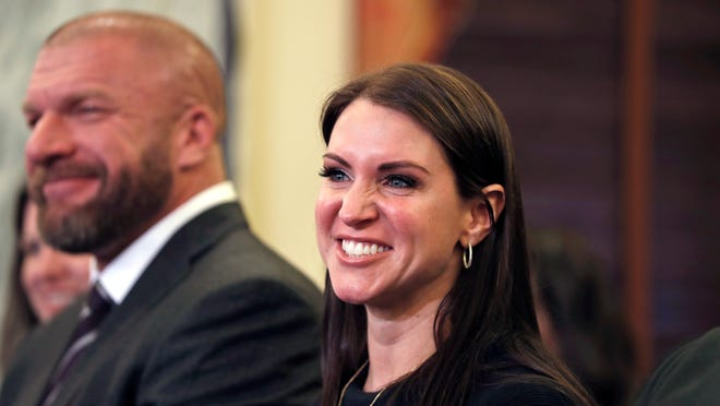 """Stephanie McMahon, daughter of Small Business Administration Administrator-designate, former wrestling entertainment executive, Linda McMahon, accompanied by her husband Paul Levesque, also know as """"Triple H,"""" smiles on Capitol Hill in Washington, Tuesday, Jan. 24, 2017, during Linda McMahon's confirmation hearing before the Senate Small and Entrepreneurship Committee"""