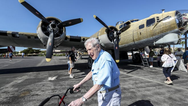 Edward Raymond Watson a former World War II pilot looks at a B-17 at Page Field in Fort Myers on Saturday. Watson flew 25 successful missions during the War.