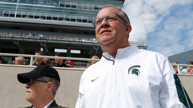 Michigan State President Lou Anna K. Simon, left, and athletic director Mark Hollis likely will be central figures in the NCAA's investigation into Larry Nassar's role with the MSU athletic department.