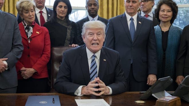 US President Donald J. Trump (C) delivers brief remarks before signing an executive order entitled, 'Comprehensive Plan for Reorganizing the Executive Branch', beside members of his Cabinet in the Oval Office of the White House in Washington, DC, USA, 13 March 2017. EPA/MICHAEL REYNOLDS