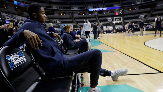 Xavier's injured player Edmond Sumner watches his teammates during practice Wednesday, March 22, 2017, in San Jose, Calif., in preparation for an NCAA Tournament college basketball regional semifinal game. Xavier faces Arizona on Thursday. (AP Photo/Marcio Jose Sanchez)