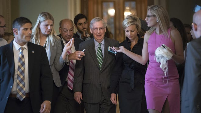 Senate Majority leader Mitch McConnell leaves the chamber after announcing the release of the Republicans' health care bill on Thursday.
